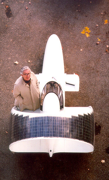 photo of James L. Amick and A4 Solitair three-wheeled single-passenger vehicle taken in October, 1992